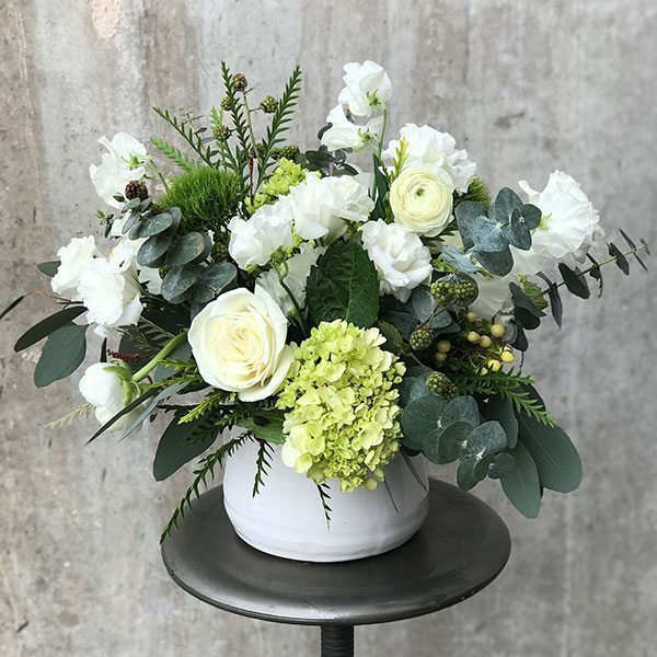 Magnifico mountain flowers of aspen white roses eucalyptus thistles and more in a white ceramic vase mightylinksfo